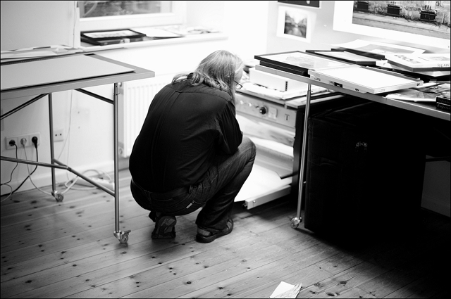 Harf Zimmermann checking a dried baryta print in his studio